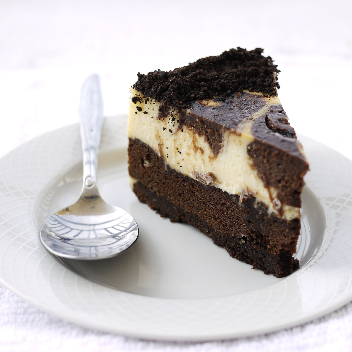 This cheesecake sits on top of a brownie crust, and has chocolate ...